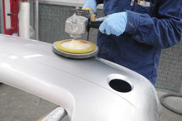 polishing a car bumper