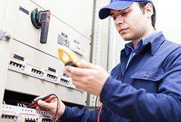 meter testing a fuseboaard