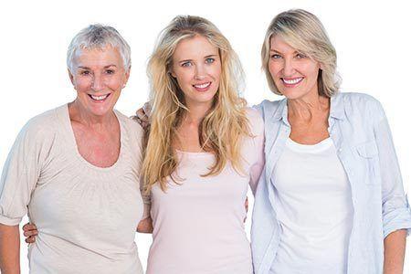 3 women posing and smiling in Cincinnati