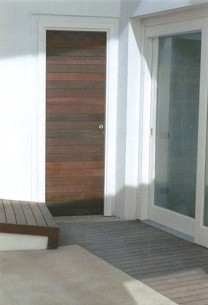 realizzazione di una porta in alluminio e legno a Oricola, AQ