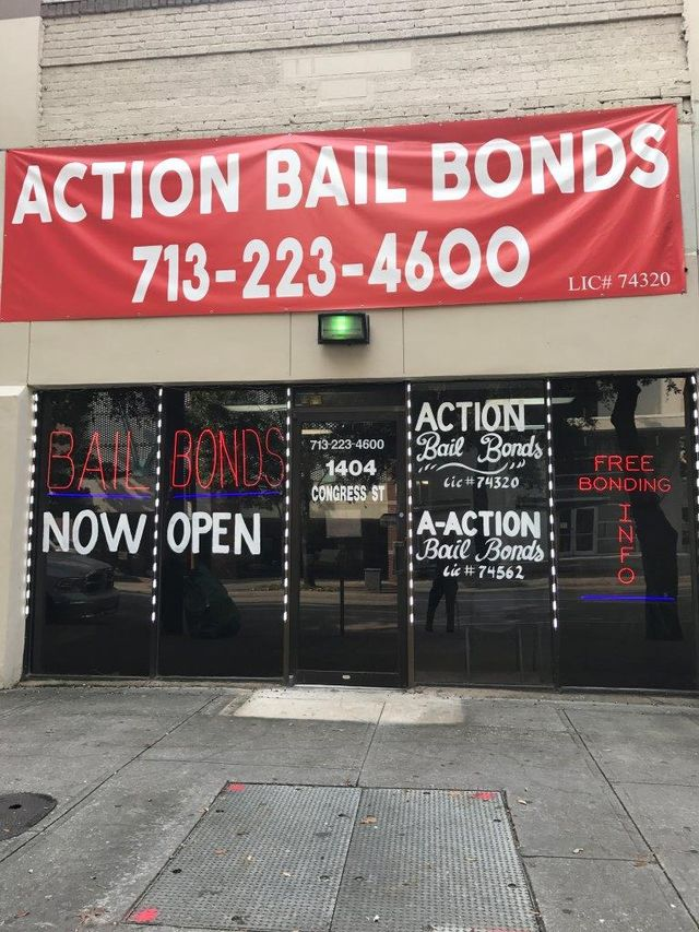 Picture of Action Bail Bond's storefront, which displays a red banner with the business name and phone number