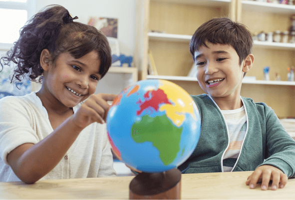 Nursery facilities -Two children playing with a globe