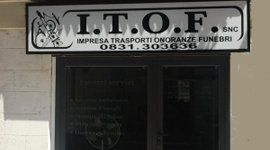 insegna agenzia funebre I.T.O.F