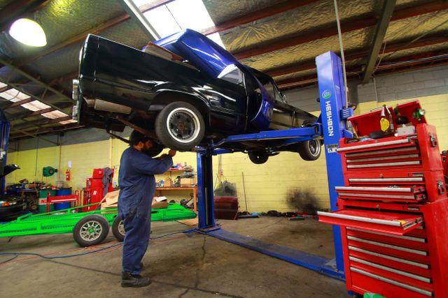 A Rotorua mechanic performing car repairs