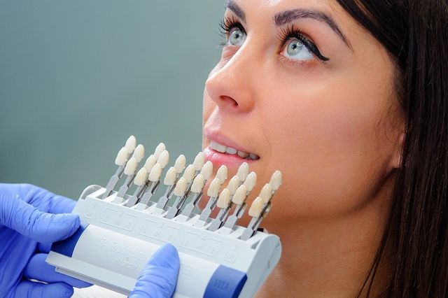Close up portrait of Young women in dentist chair.
