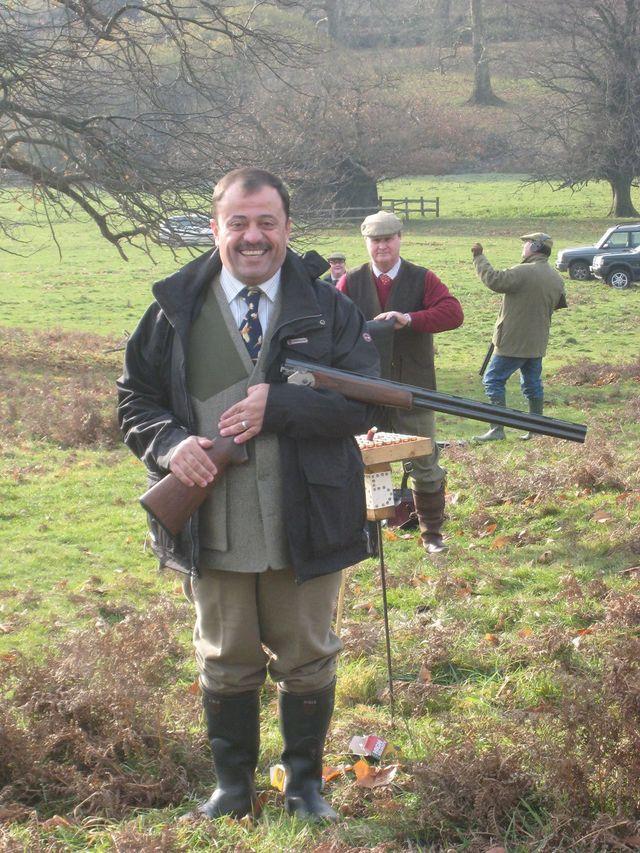 British Country Sports man holding a gun