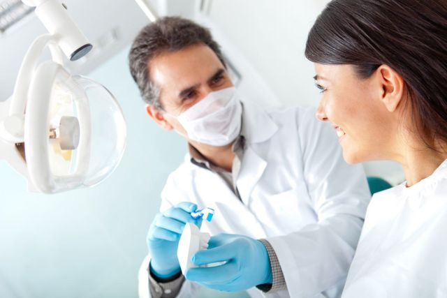 Dentist giving tips on oral hygiene in Kailua, HI