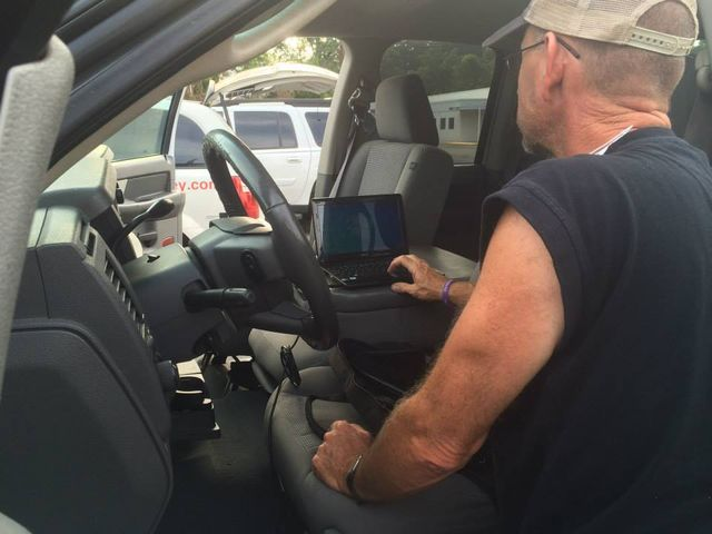 man providing emergency car key replacement in Greensboro, NC