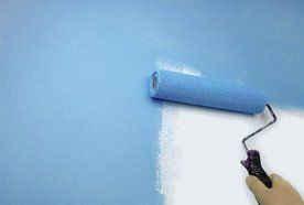 A wall being painted blue