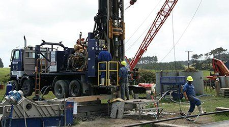 Experts at the project site working on well drilling