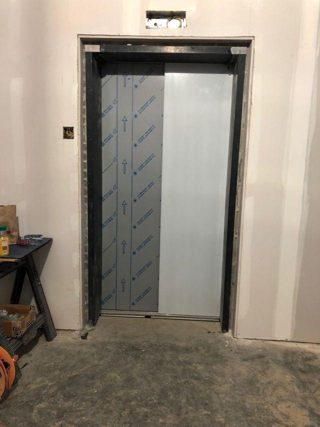 Elevator Installation Service — Elevator with Opened and Closed Doors in Newark, DE