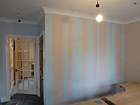 room decorated in pale blue and beige stripes