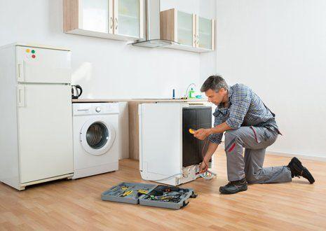 Appliance Repair — Repairman Fixing a Washer in San Antonio, TX