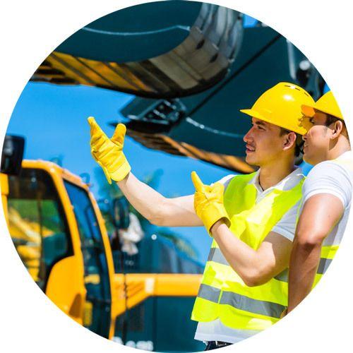 men working with excavators