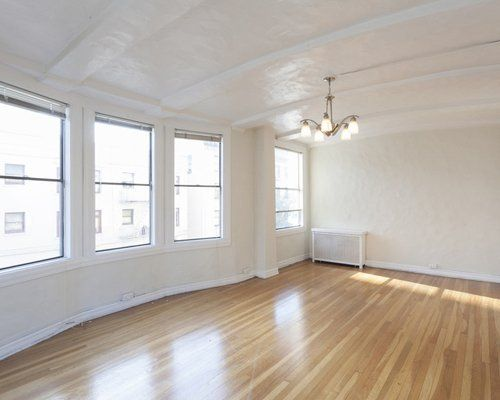 A large spacious room with laminate flooring