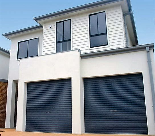 A house with roller doors in Batemans Bay