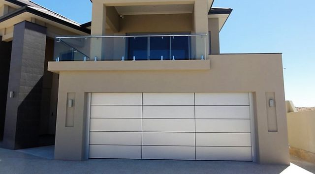 A house with panel lift doors in Moruya