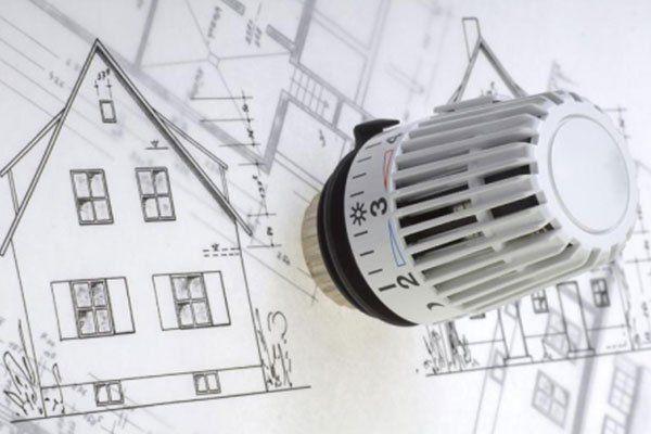 una manopola di regolazione di un termosifone e un disegno diu una casa