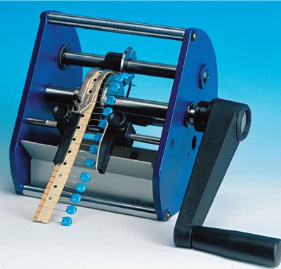 Macchina manuale taglia componenti radiali nastrati