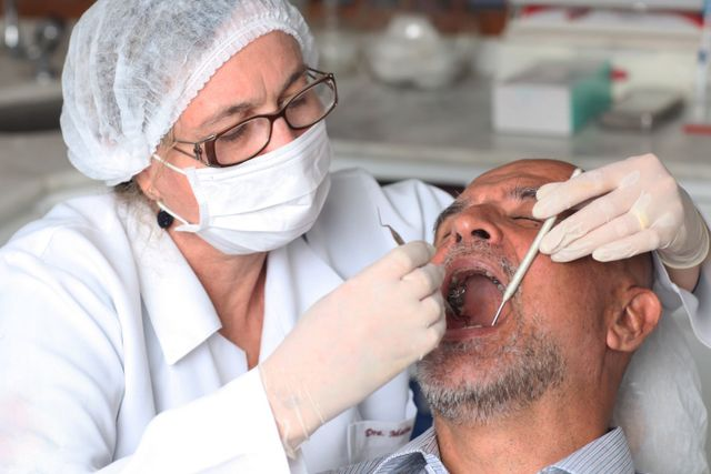 Man getting his teeth looked at