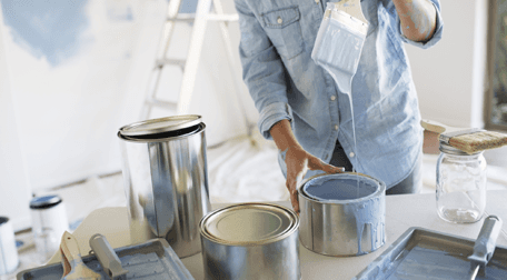 A decorator mixing paint