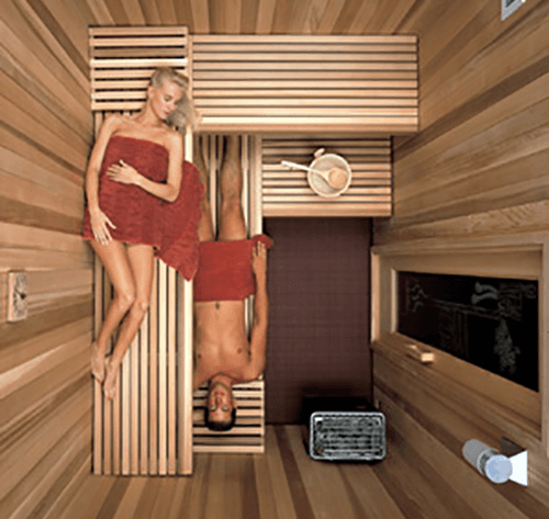 Couple in a wood sauna room in Anchorage