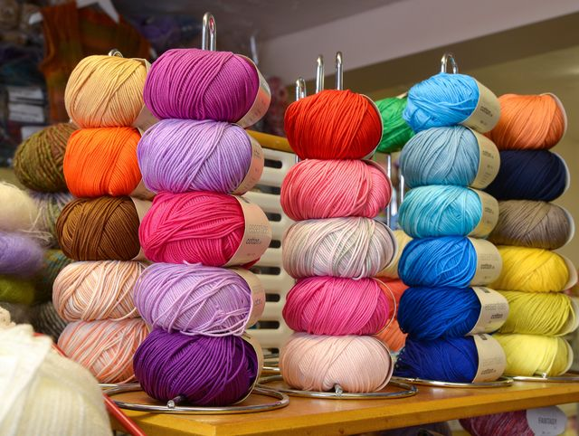 Shelves of coloured wools