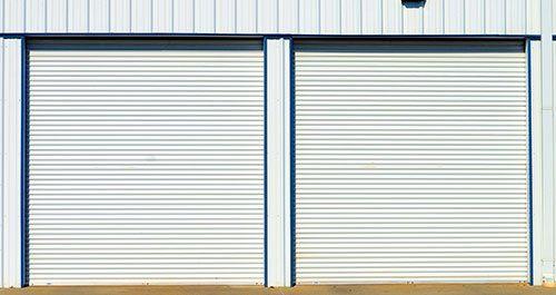 Overhead white steel doors at storage
