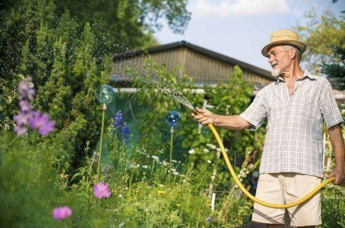 irvine industries man watering garden