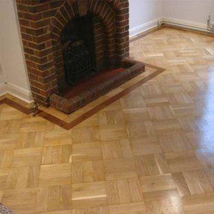 parquet flooring surrounding 1930s fireplace