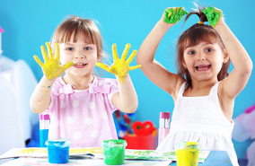 children showing their coloured hands