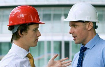 2 builders discussing plans