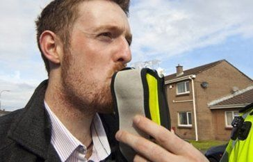 man taking a breath test for alcohol