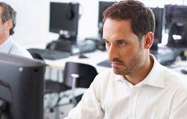 man looking stressed at work
