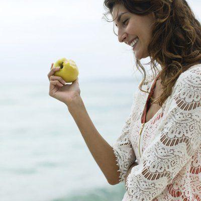 a lady eating fresh fruit