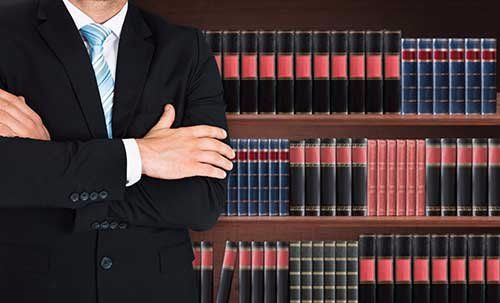Legal representative with the legal reference material in Doncaster