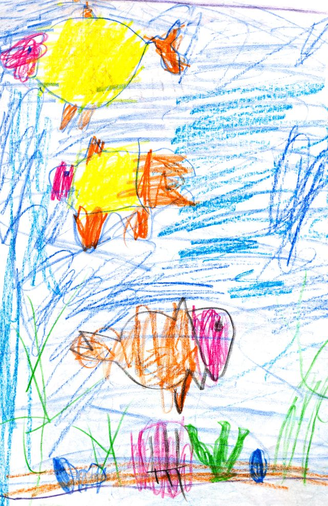 Children's crayon drawing of fish under the sea