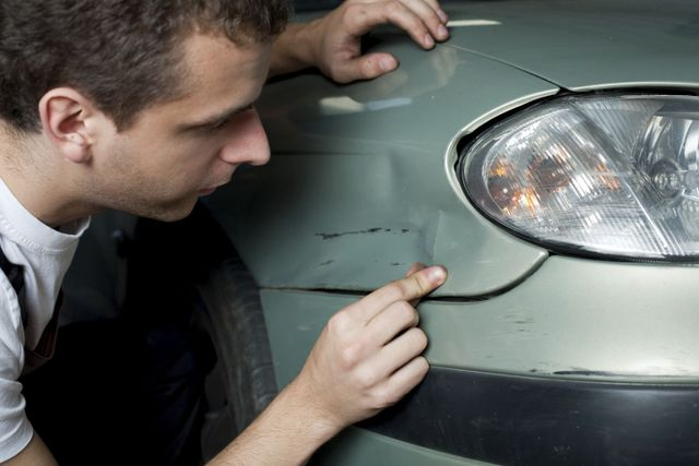 Mechanic working on collision repairs in Shelbina, MO
