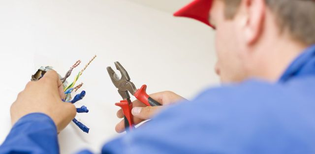 One of our reliable staff performing electrician services