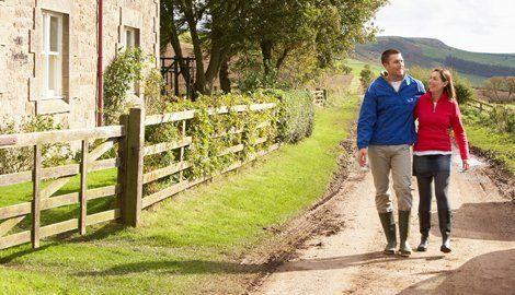 couple walking in a farm