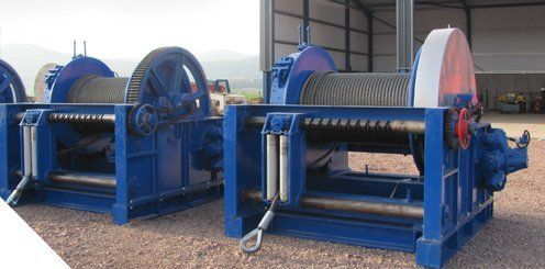 Drum base mounted winch