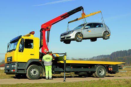crane lifitng a car