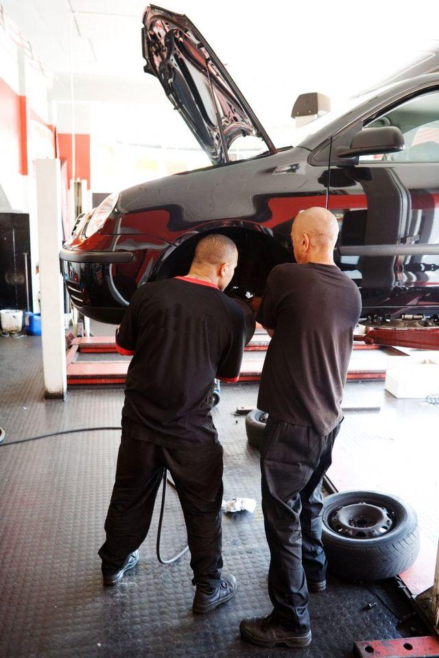 Mechanics placing car spare parts in Whangarei