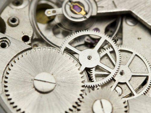 degli ingranaggi di un orologio