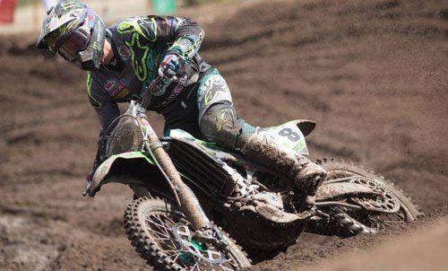 Individual riding his bike through mud