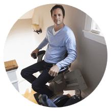 a man sitting on the stairlift