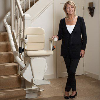 Woman using curved stairlift