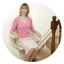 a lady sitting on the stairlift