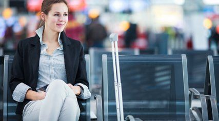 a lady waiting at the airport