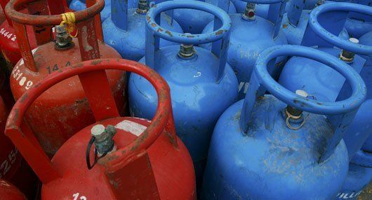 blue and red gas cylinders